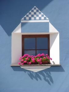 window-in-the-facade-of-dolomite-house-1383065-m